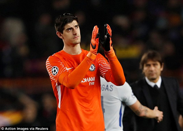 Courtois applauds the Chelsea travelling support after they were knocked out of Europe