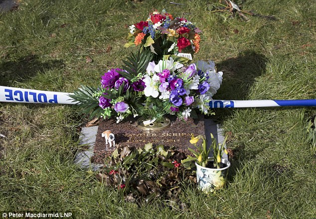 Police cordon tape surrounds the grave of Alexander Skripal, son of former Russian spy Sergei Skripal, in the cemetery in Salisbury