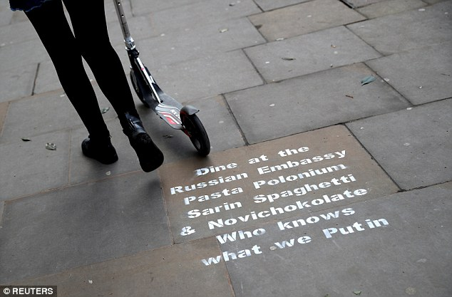 Graffiti sprayed on the pavement near the entrance to the Russian embassy and ambassador's residence in London yesterday