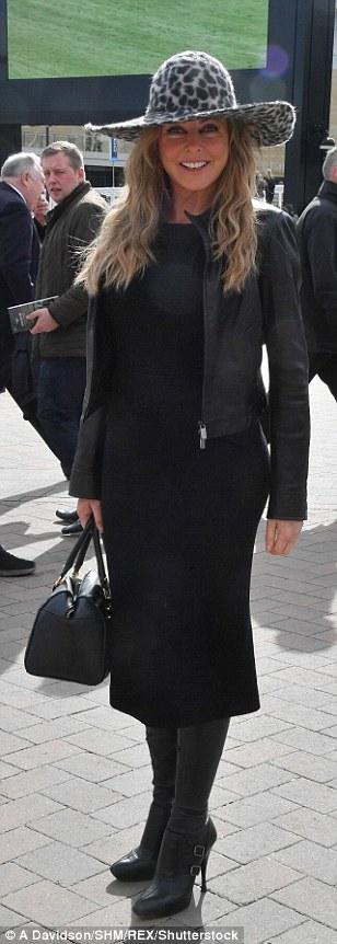Carol Vorderman sported a figure-hugging black dress and an oversized leopard print hat