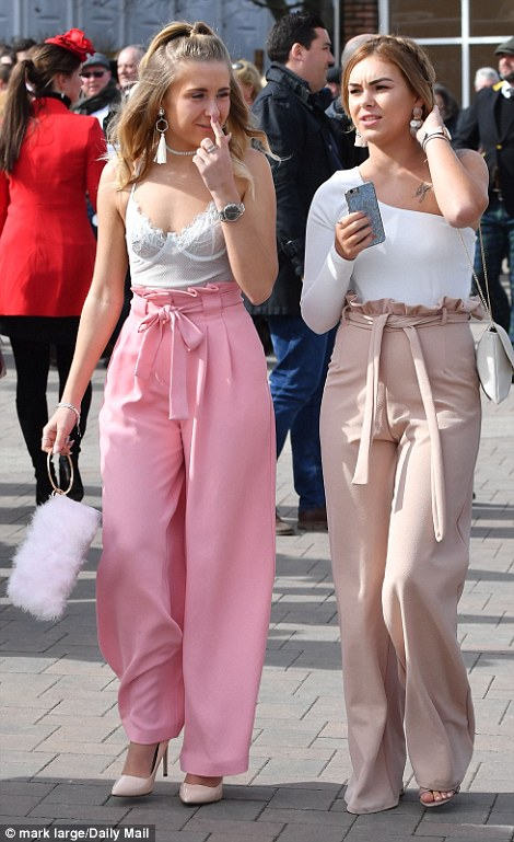 Friends braved the chilly spring weather in skimpy tops and pink high-waisted trousers