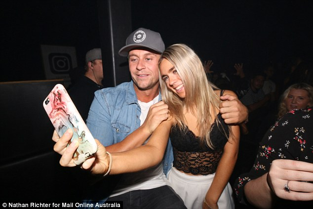 Precious memories: Ryan couldn't wipe the smile off his face the whole night as he mingled with partygoers and snapped selfies
