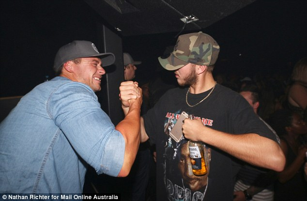 Brothers: Ryan proved he still had time for male fans as he engaged in a friendly arm wrestle