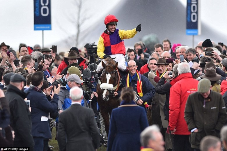 Thumbs up! Champion jockey Richard Johnson looked thrilled as he celebrated his victory in the Gold Cup