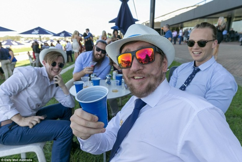 The men got in on the fun too, many wearing simple white shirts topped with groovy white fedoras and bright sunglasses