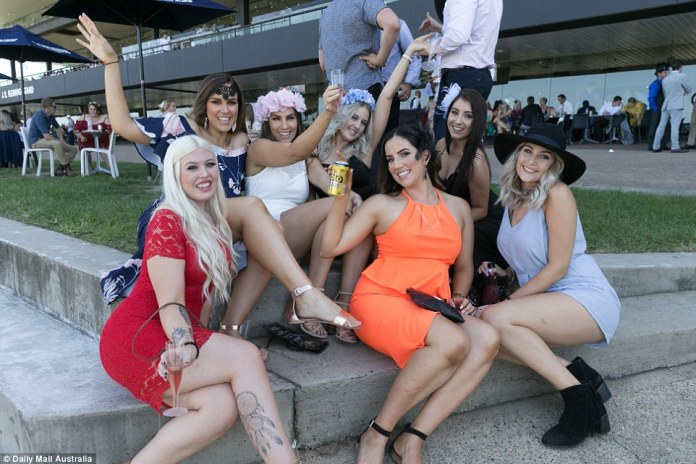 Getting into the race day spirit, some women were seen donning extravagant flower crowns with champagne flutes in hand