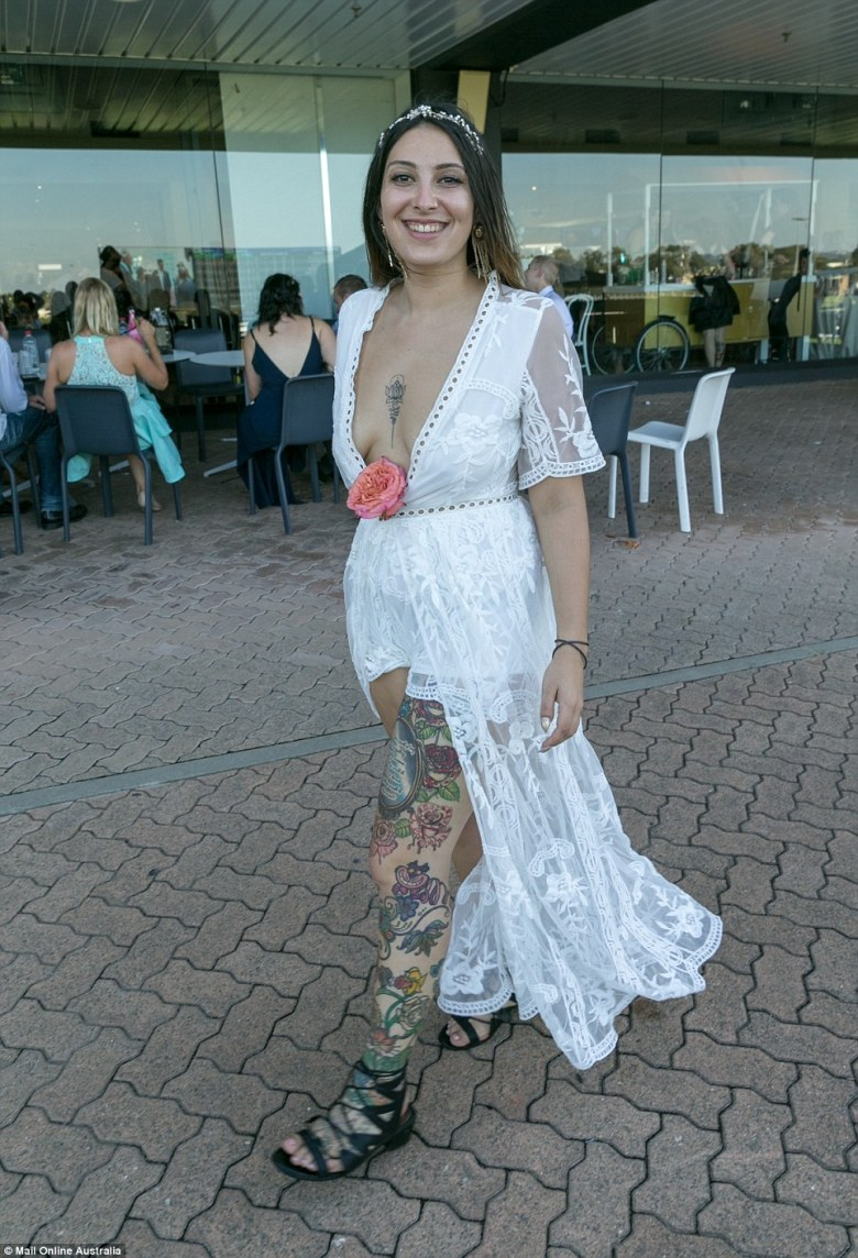 One racegoer wore a white lace dress with a plunging neck line complete with a large pink rose and crystal head band
