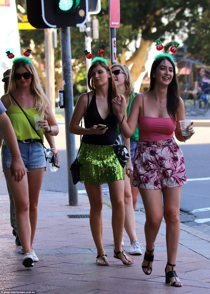 Some people were spotted wearing touches of green head to toe complete with quirky leprechaun headbands (pictured)
