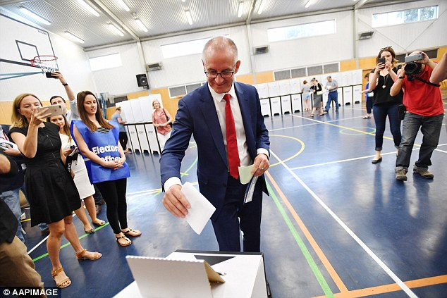 South Australia Premier Jay Weatherill votes during the state's election on Saturday