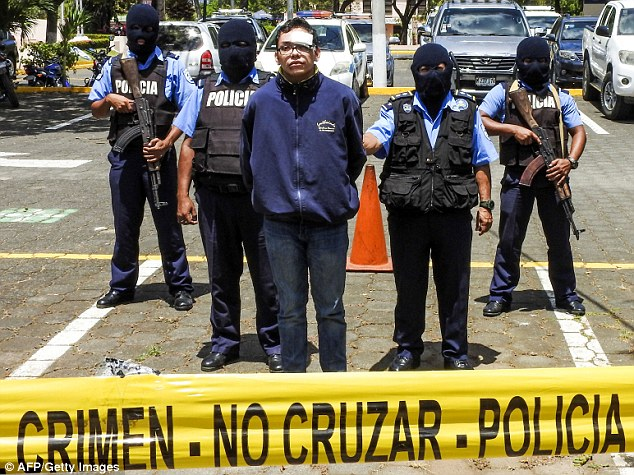 Tercero was photographed surrounded by armed police in balaclavas, bleeding from the lip with a bandage across his left eye