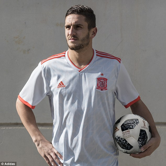 Spain's Koke shows off their change shirt for the World Cup - a white, blue and red design
