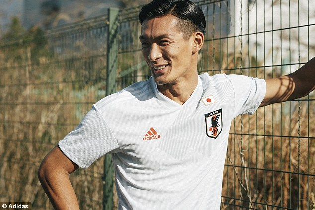 Japan's new away strip is a minimalist white and grey design for the World Cup
