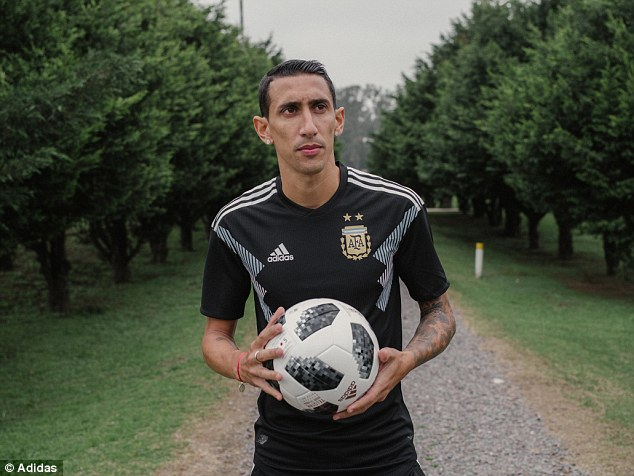 Angel Di Maria on the ball wearing the new Argentina away strip for the World Cup finals