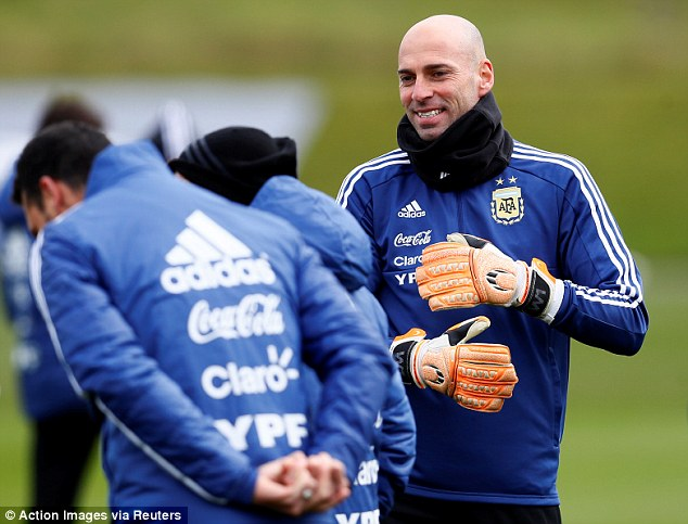 Chelsea goalkeeper Willy Caballero wrapped up warm for the session in cold temperatures