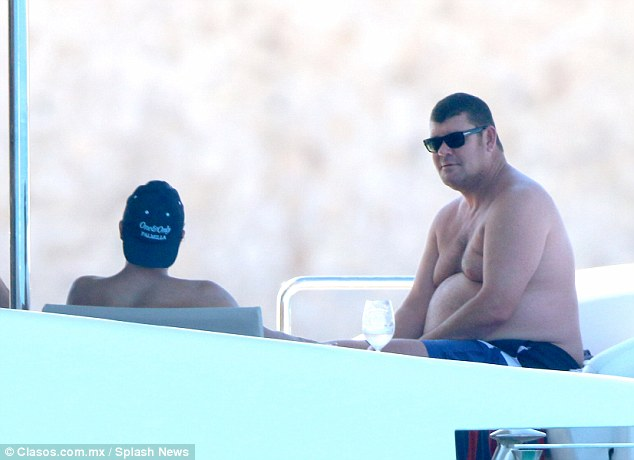 Billionaire James Packer relaxes on a yacht in the waters off Los Cabos in Mexico last year