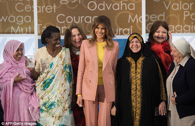 The first lady donned a pink suit and a bright yellow top to honor the 10 recipients of the award