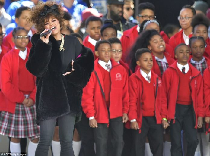 Singer Andra Day kicked off the performances in Washington DC rally with a children's choir from Baltimore who sang her hit Rise Up with her