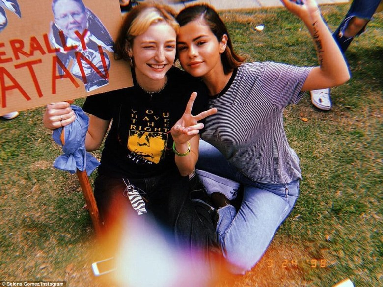 Selena Gomez wrote on Instagram: 'I don't want this to just be an Instagram post anymore. PLEASE. ENOUGH. These people, families and CHILDREN have suffered enough. Today we march for our lives. I'm going to continue to trust god with the future and also play my part in bringing change'