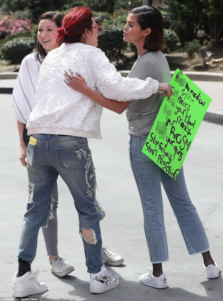 Teaming up: The stars were seen sharing a friendly embrace as they took the streets to demonstrate against gun violence with thousands of other marchers