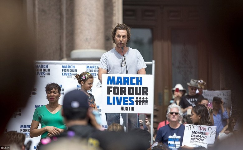 Matthew McConaughey speaks during the march in Austin, Texas, next to his daughter (left)