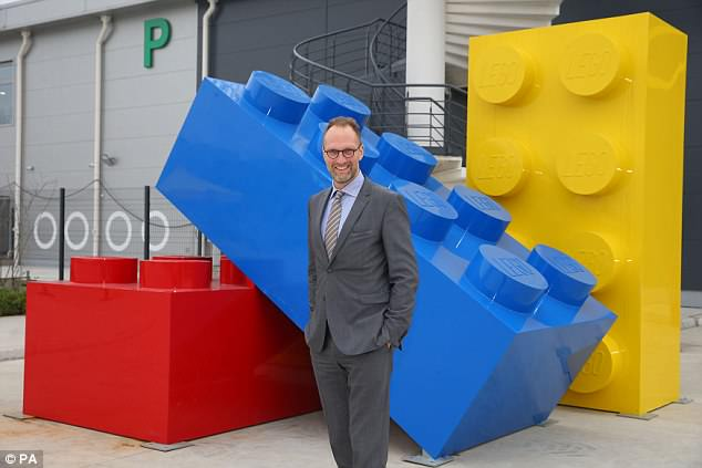 Musk's Boring Company uses massive machines to dig tunnels that can support high-speed transit systems under cities. Extracted materials leftover from the projects will be used to construct the strange sounding observation post at the firm's headquarters in California. Pictured is LEGO Group chairmanJorgen Vig Knudstorp with some novelty-sized bricks