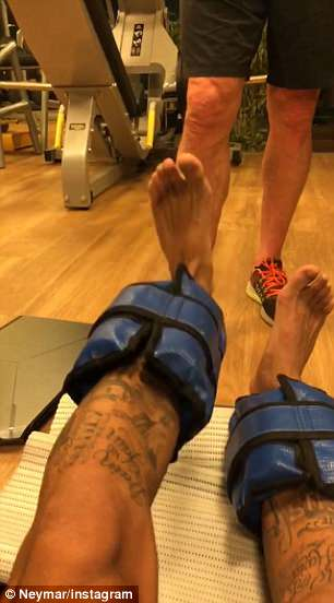 Neymar lifts his left leg while it is strapped with weights on Thursday evening