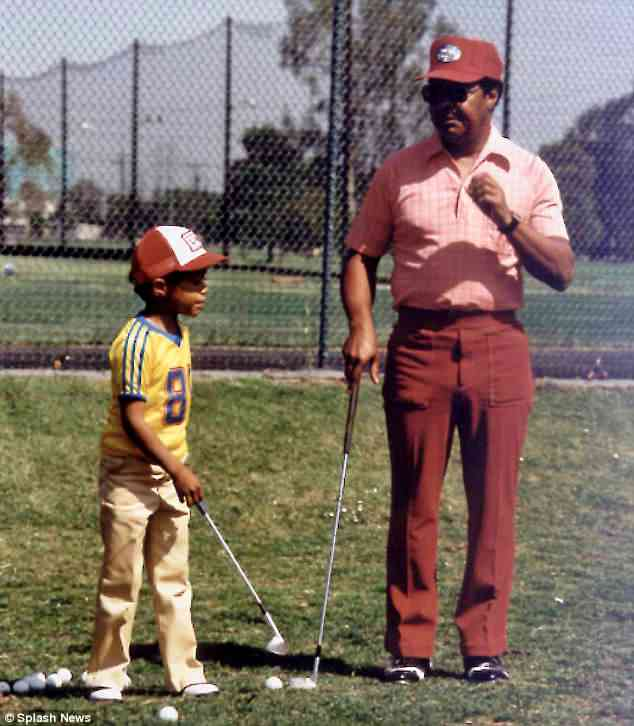 On course to win: A young Tiger is seen being mentored at golf by his father. A new biography simply titled Tiger Woods claims Woods Sr made their family home in California a 'house of horrors'