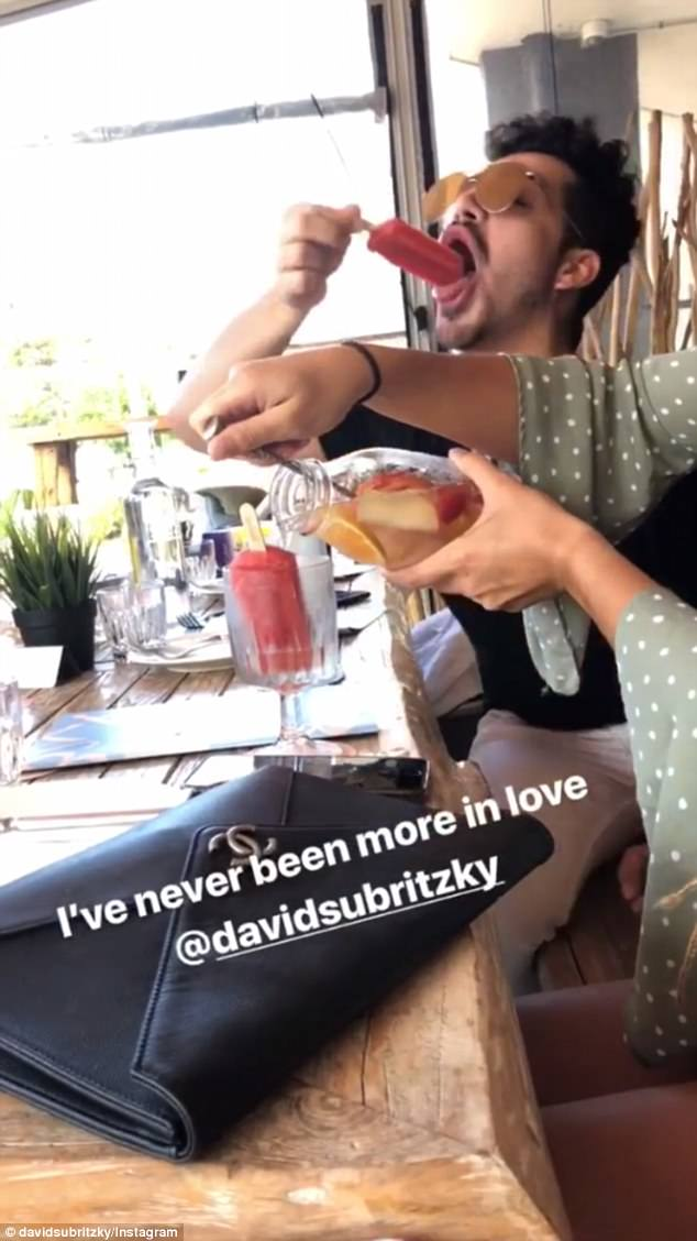 That's love!For the announcement, she captioned an Instagram story video of David putting an ice block into his mouth during a boozy lunch
