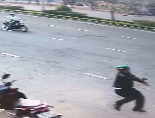 The man in the green helmet then pulled out his own gun and pointed it at the rival group