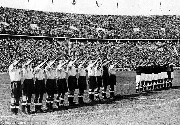 Russia has taunted Britain with an infamous photo of England's 1938 football team (left) performing Nazi salutes