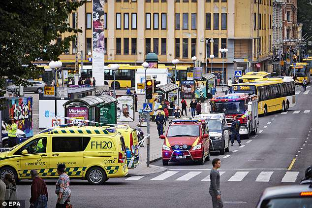 Scene: Emergency services are seen at the site of the stabbings in August last year