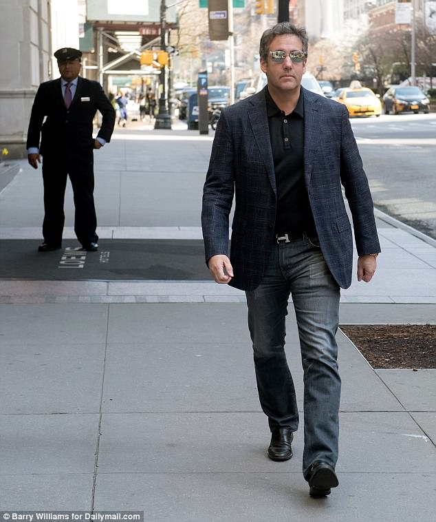 President Trump's longtime attorney Michael Cohen leaves the Lowes Regency Hotel on the way to his parking garage on Saturday morning. He denies new reports he went to Prague