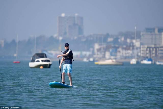 A person takes part in some water sports in Southend as he takes advantage of a sunny Saturday to go outside today