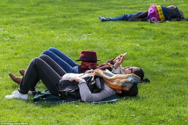 Tourists and Londoners enjoyed warm spring sunshine in St James Park in Westminster with more sunny weather expected