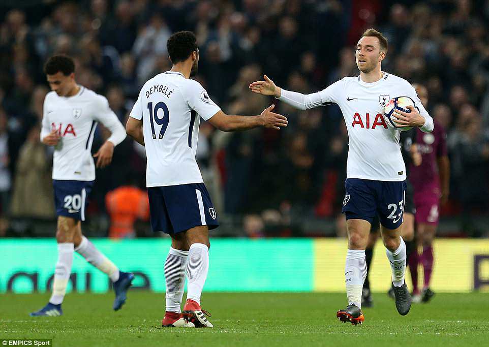Eriksen was congratulated by team-mate Mousa Dembele as the pair touched hands on their way back to their own half