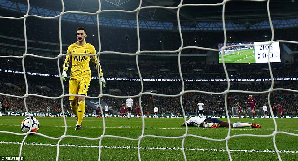 Spurs goalkeeper and captain Hugo Lloris looked dejected as he walked back to gather the ball from the back of his net