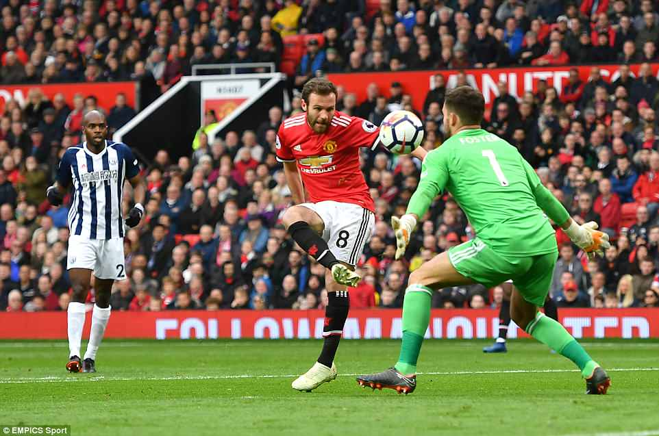 Manchester United midfielder Juan Mata fails to fire his side into the lead as his shot is blocked by goalkeeper Ben Foster