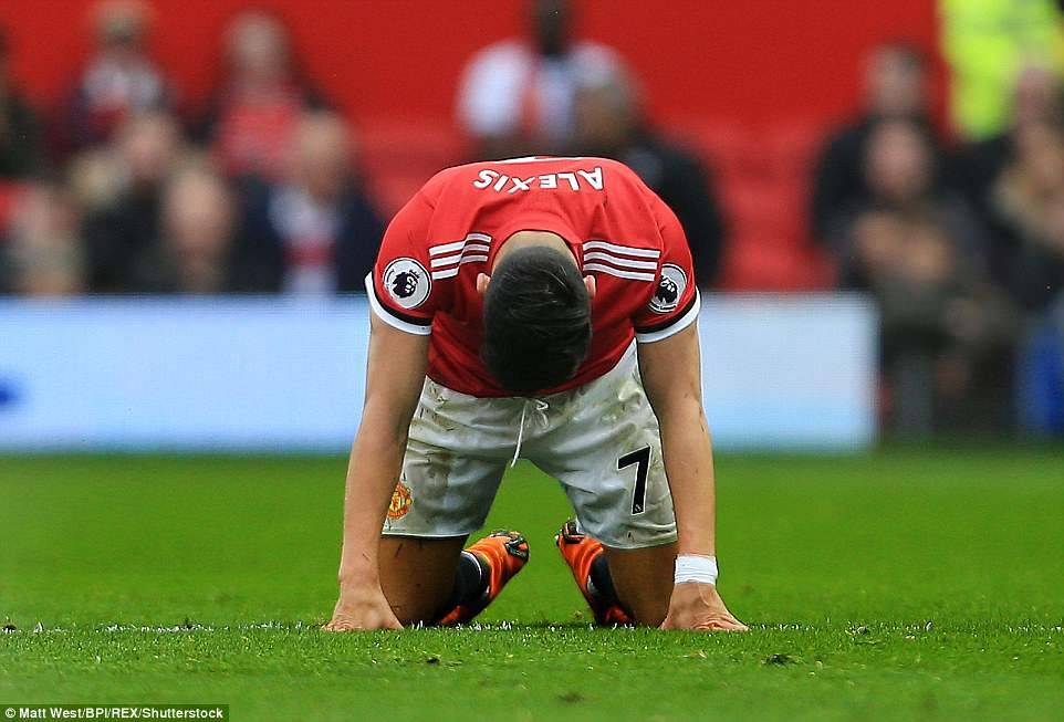 Manchester United star Sanchez falls to his knees in dejection on a thoroughly frustrating afternoon for his team