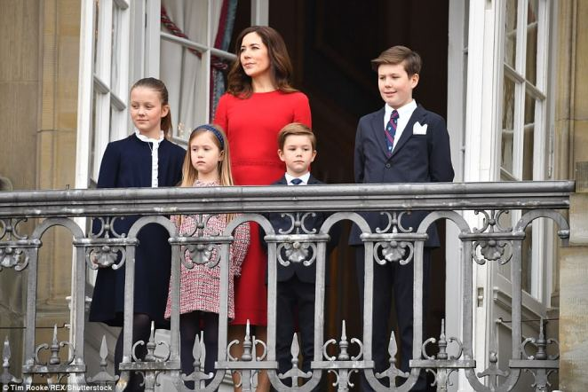 Crown Princess Mary, wearing a red dress, stood proudly behind her brood, (left to right) Princess Isabella, twins Princess Josephine and Prince Vincent, and Prince Christian