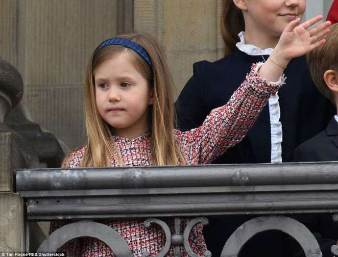 Give us a wave! Princess Josephine, wearing a tweed coat dress and with a smart navy blue band in her hair, did eventually offer a wave - albeit with a very solemn expression on her face