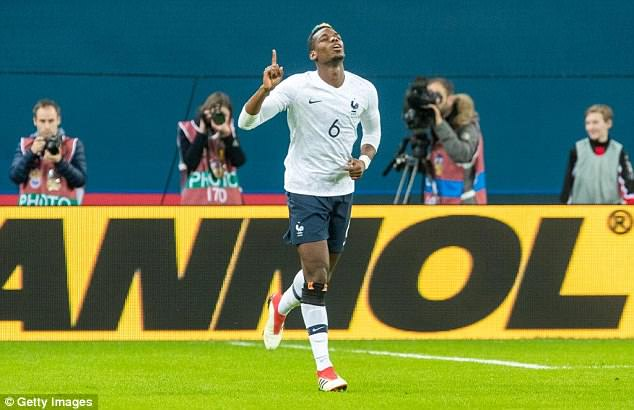 Manchester United midfielder Pogba celebrates after scoring during France's friendly win