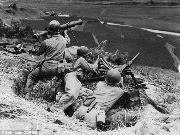 U.S. Marines covering the road leading to the front lines in South Korea in 1950