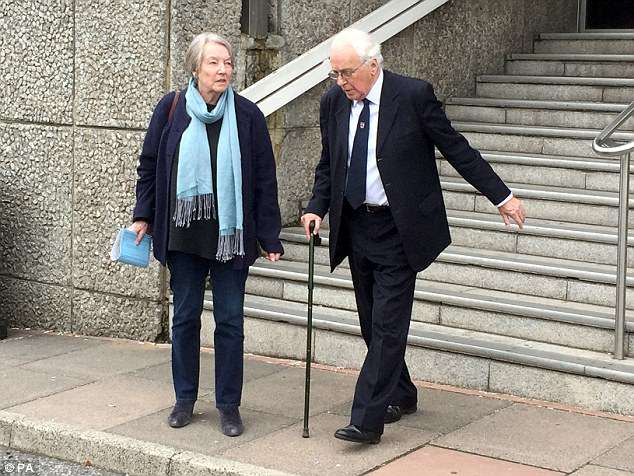 Former Christ's Hospital School headmaster Richard Poulton leaving Brighton Crown Court with his wife, after Ajaz Karim, 63, denies nine charges of indecent assault