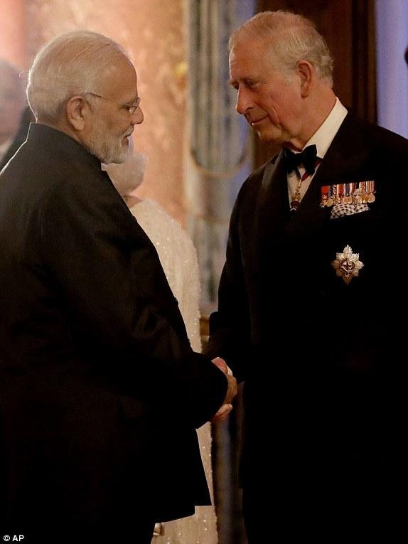 Image result for Narendra Modi walking towards Theresa May and Baroness Scotland at St James's Palace at the start of the summit