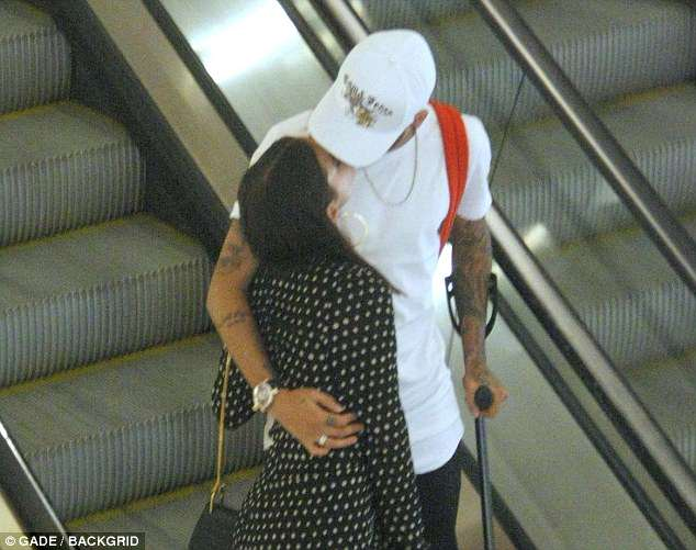 The PSG striker gives his girlfriend a kiss and a hug as they browse shops in the Brazil capital
