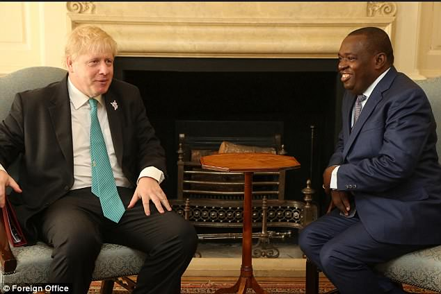 Boris Johnson (pictured today at the summit with his Zimbabwean counterpart Sibusiso Moyo sad he will support the country's path to reform