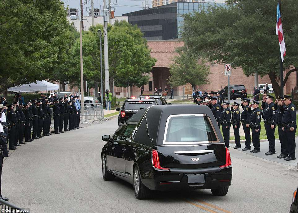 Police salute as Barbara Bush's hearse is driven away from St Martin's Episcopal Church in Houston, Texas