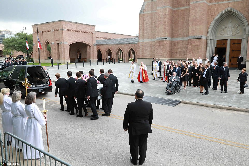 A solemn moment of quiet fell on the street outside the church as Mrs. Bush's casket was carried in to the hearse by her grandsons
