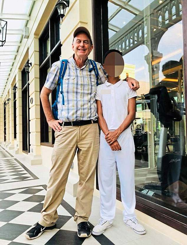 Peter Dalglish, pictured with a young male acquaintance, is a former Unicef and WHO official and was found with 'two young boys at his home in Nepal'
