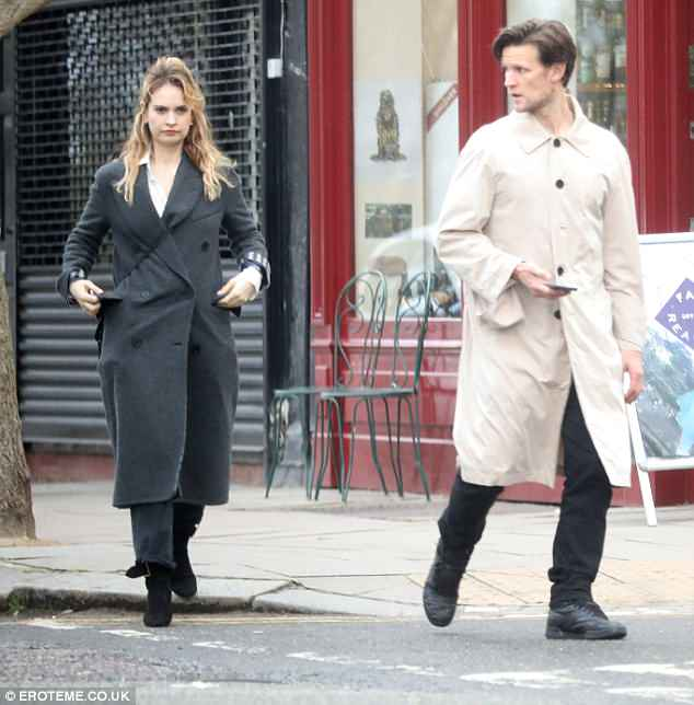 Sophisticated display: The Cinderella actress, 29, cut an effortlessly chic figure as she wrapped up in a grey longline coat, tied in with a pair of dark wash jeans